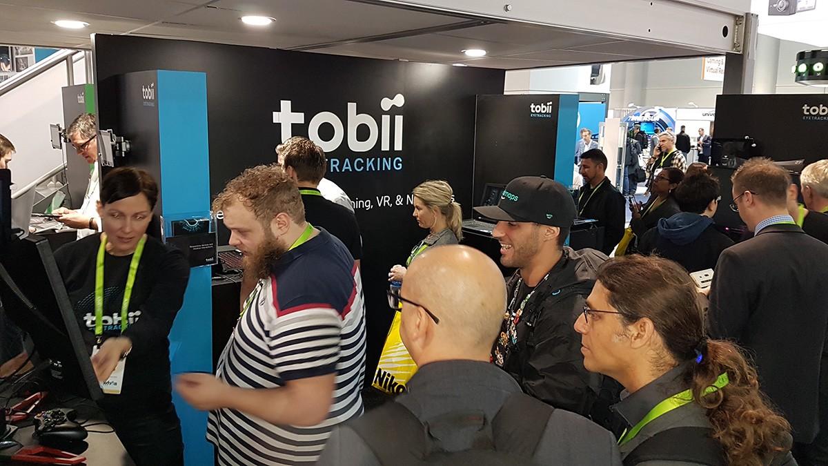 Visitors-line-up-at-the-Tobii-booth